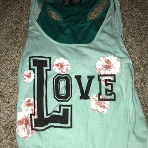 "Blue ""love"" tank with bra cover underneath"